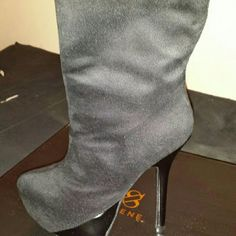 """*Brand new* Faux Suede platform boot Zip up entry. Heel and platform are shiny black material. About 13"""" to top of boot so stops about mid calf. Platform is 2 inches to give support. Never worn outside the house. Brand new with box Shoes Heeled Boots"""