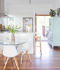 I like the glass-topped table and those chairs, but the best thing is that large aqua cabinet on the right (which is actually in the kitchen). So pretty!