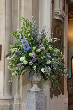 Large urn, NOT these colours obvs and with more trailing foliage to side