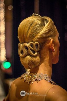 Go for the royalty look! Great hairstyle for standard and suitable for latin as well. Visit http://ballroomguide.com/comp/hair_make_up.html for more hair and makeup info