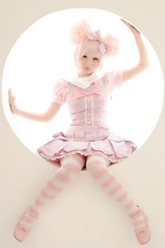 Harajuku doll.  Pale pink stripe tights.  Pink and gray plaid school girl dress.