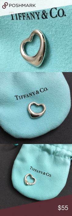 Tiffany Open Heart Pendant Tiffany open heart pendant only (no chain). Comes with a pouch, but no box. I recently got this cleaned at a Tiffany store on 3/5/17. It has some minor scratches on one side, and I tried to get pictures of it (last photo). Tiffany & Co. Jewelry Necklaces
