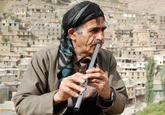 "Kurdish ""dengbêj"" [storyteller] playing the blur [Kurdish flute related to the ney, frequently made in metal] :: Horaman, Kurdistan"