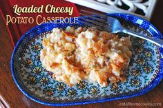 loaded cheesy potato casserole done  oven or crock    Wrap ham or smoked sausage in foil and place on top of the potatoes in the crockpot.  This is a quick way to heat it all together, but avoid having the ham or sausage taste permeate the casserole.