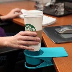 Drink clip to keep drinks off your desk and away from spilling on your computer. Genious!!!