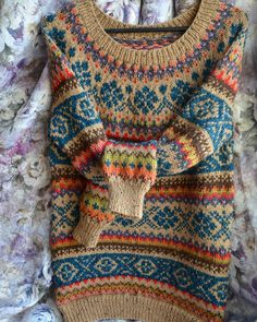 Continue the fair isle through the body from a yoke sweater. Can be done on the machine. Like the color combination.