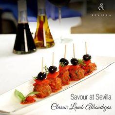 The stellar Classic Lamb Albondigas stands out amidst the extensive Tapas menu at Sevilla