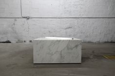 MARBLE WITH FLUORESCENT TUBE  BY CASTOR DESIGN