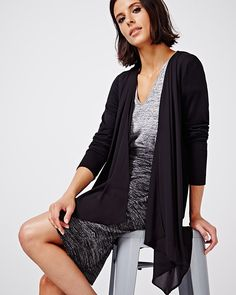 This long cardigan with chiffon will look great with everything in your wardrobe! Try pairing it with a blouse and trouser for a professional look. <br /><br />- Open front<br />- Long sleeve <br />- Chiffon detail at the front