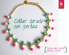 Collar de cadena dorada y perlas de colores.