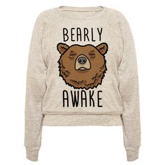 "This lazy bear design features the animal pun ""Bearly Awake"" with an…"
