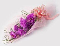 Cómo hacer una flor con papel crepé y chocolates adentro