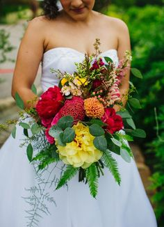 yellow and red bouquet - photo by Amber Vickery http://ruffledblog.com/mid-century-mexican-wedding-at-the-belmont-dallas