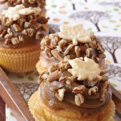 Pecan Pie Cupcakes - Pecan Pie is the quintessential dessert of fall. Crunchy toasted pecans and buttery Piecrust Leaves enhance the rich creamy frosting for a cupcake you'll make again and again.