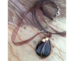 Black agate pendant necklace with copper and bronze colour wire wrapping and green magnetic beads. Perfect gift for Valentine's Day.
