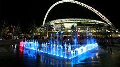 Wembley Stadium fountains at night in Wembley Park, London, England. elonearth.com
