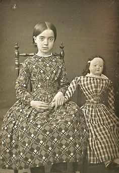 c. 1860-80s.....Neither child nor doll look too happy!
