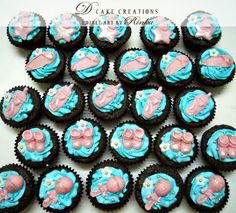 Chocolate Cupcake with fondant baby essentials toppers.