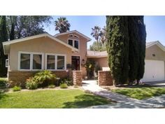 Single Family Residence - San Diego, CA - $625,000  This beautiful home with character will charm you as you see the entrance! Comfortable living, spacious & open floor plan. The remodeled kitchen with sparkling granite counter tops & custom made cabinets opens to the dining & family room. Formal living room & large master bedroom with sitting area with fireplace & cathedral ceilings, two walk-in closets.