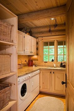 Rustic Laundry Room with specialty door, Built-in bookshelf, High ceiling, Exposed beam, Hardwood floors, Undermount sink