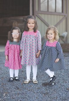 Just in time for fall, this lovely long sleeve dress is an easy and fun project! It is adorable as a dress or over leggings or even jeans. Back is designed with button closures, but could be snaps to make it even simpler.