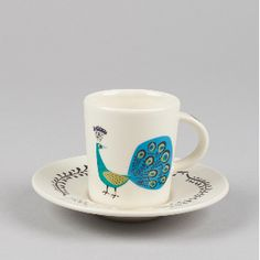 Hannah Turner Peacock Espresso Cup and Saucer: The Hannah Turner peacock range is both elegant and stylish. Each product is handmade and embellished with beautifully illustrated designs of elegant strutting peacocks. This sweet little espresso cup and saucer are perfect for that coffee kick.