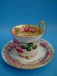 Early 20th C Coalport Empire Shape Coffee Cup & Saucer, c.1825 painted with pink rose heads on gilt