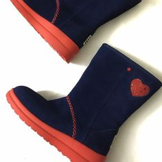 I ❤️ UGG boots! Navy blue UGG boots with red hearts. Brand new, never worn. Do not come with box as I purchased them without one! 100% Authentic! Concealed pocket inside the right boot! UGG Shoes