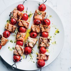 Cook these simple salmon-and-tomato kebabs on skewers or even on sturdy rosemary sprigs.Slideshow: More Salmon Recipes Easy Salmon Recipes, Fish Recipes, Seafood Recipes, Korean Recipes, Salmon Skewers, Bbq Skewers, Kabobs, Grilling Recipes, Cooking Recipes