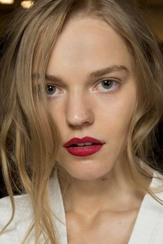 Super-fresh skin and mussed up hair are easily achieved at a festival; just take the look to the next level with a blotted-out matte slick of red lipstick to perfect the Burberry SS15 look.