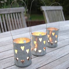 Hanging Stars Lantern by Clem & Co, the perfect gift for Explore more unique gifts in our curated marketplace. Garden Lanterns, Hanging Lanterns, Dyi Lanterns, Solar Powered Garden Lights, Lantern Designs, Tin Can Crafts, Hanging Hearts, Tea Light Holder, Seasonal Decor