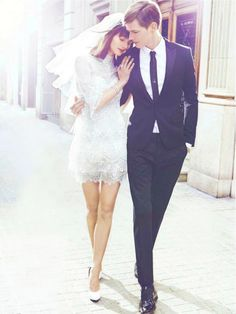 oh so chic couple - I do love a short wedding dress + 60s esque pouffy veil combo