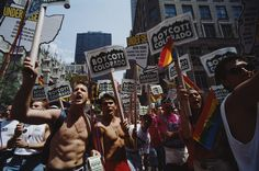 "Photographer: Barbara Alper, 1994 Men and women carry placards that read ""Boycott Colorado"" at the Gay Pride parade in New York City in June of 1994."