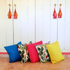 For home and for outside. Cotton decorative pillows with cactus print and multicolored
