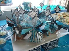 baby shower ideas   Outdoor decor included blue zebra themed diaper cakes as table ...