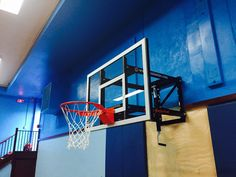 Here's a photo of the finished product after the professional installation of a Goalsetter wall-mount basketball system by Best in Backyards of NY and CT. Learn more about Goalsetter wall-mount models, all of which offer height adjustability, here: http://www.bestinbackyards.com/basketball/wall-mount-systems