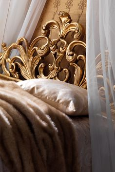 Shown here in an antiqued gold finish to the unique swirls and curves of the ornate carved headboard and frame. The High End Designer Gold Rococo Bed at Juliette's Interiors is a beautiful addition to any bedroom, adding the ultimate in style and opulence to any setting. Glamorous, yet flamboyant and sophisticated!