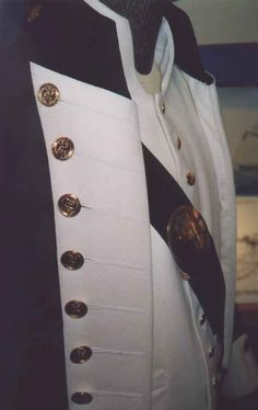 Zoom in view of the detail on a replica tunic of a British Royal Navy Lieutenant's Uniform, circa 1800-1811.