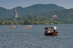 Hangzhou: West Lake check out more Top 10 Best Attractions To Explore In Different Cities Of China http://www.ourlovefortravel.com/2014/03/18/top-10-best-attractions-explore-different-cities-china/