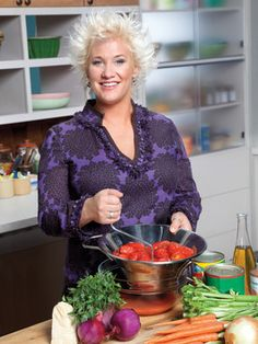 Anne Burrell ~ Her hair says it all.  But really, great chef who cooks beyond the ordinary but makes it seem possible for home chefs to do the same.  Plus she is just fun to watch in the kitchen.  Her passion for food is evident through her expressions.  And she knows what's what in the way she moves about the kitchen.  I don't think her hands ever hold still...even when she talks.