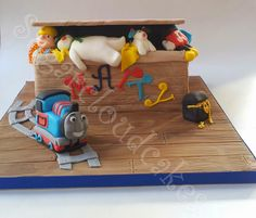 Toy box cake filled with mickey, Bob, the snowman and thomas