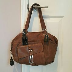Gorgeous L.A.M.B leather handbag! Absolutely awesome L.A.M.B handbag! Sporty look. Pre-loved but still in great conditon. There are ofcourse a few bumps and bruises from use, but so tiny that it's hardly even noticeable and impossible to photograph. L.A.M.B. Bags Totes