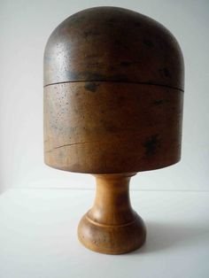 Early 18th century French solid wood hat form with original pedestal.