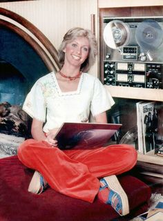 Olivia Newton John with her records and Reel-to-Reel tape player. http://www.pinterest.com/TheHitman14/celebrity-audio-%2B/