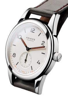 The NOMOS Club is their most affordable offering. The case is 36mm and houses the in-house Alpha movement. Sportier, younger: The smallest watch in the Club series. The steel case not only takes compl