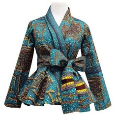 Style Stand out in our beautiful Diola African print blazer. This African print blazer features a teal and yellow African print, with a slimming peplum style fit. Pair this blazer perfectly wi African Inspired Fashion, African Print Fashion, Africa Fashion, Fashion Prints, Fashion Design, African Print Dresses, African Fashion Dresses, African Dress, African Prints