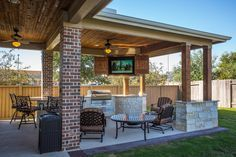 Custom Outdoor Covered Patio Such a unique piece! Tongue and Groove ceiling custom cabinets to hide the outdoor television cozy patio furniture and the best part of all a built in fire table!