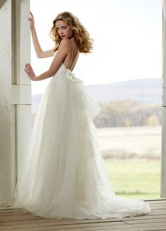 Fitted slim sheen lace bridal gown with Organza and Tulle illusion overskirt.