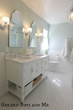Paint color = sherwin Williams sea salt Golden Boys and Me: Master Bathroom with pedestal tub, white subway tile, carrera (with sources)