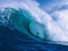 Garrett McNamara shooting the curl of Jaws, a wave break at Peahi Bay on the…